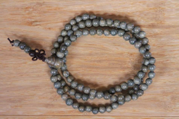 Green Sandalwood Mala with Dharma Wheel